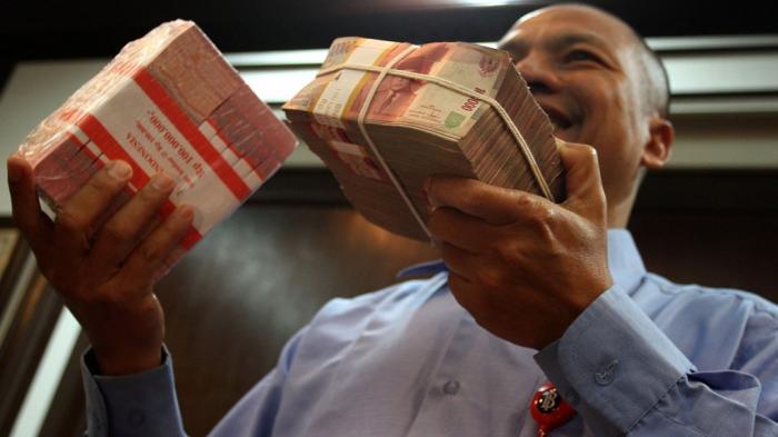 bi-musnahkan-uang_duit_rupiah